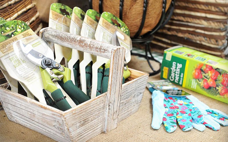 secateurs and gardening gloves