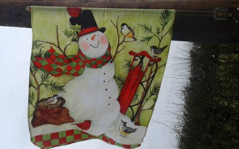 Snowman flag at Kiln Farm Nursary