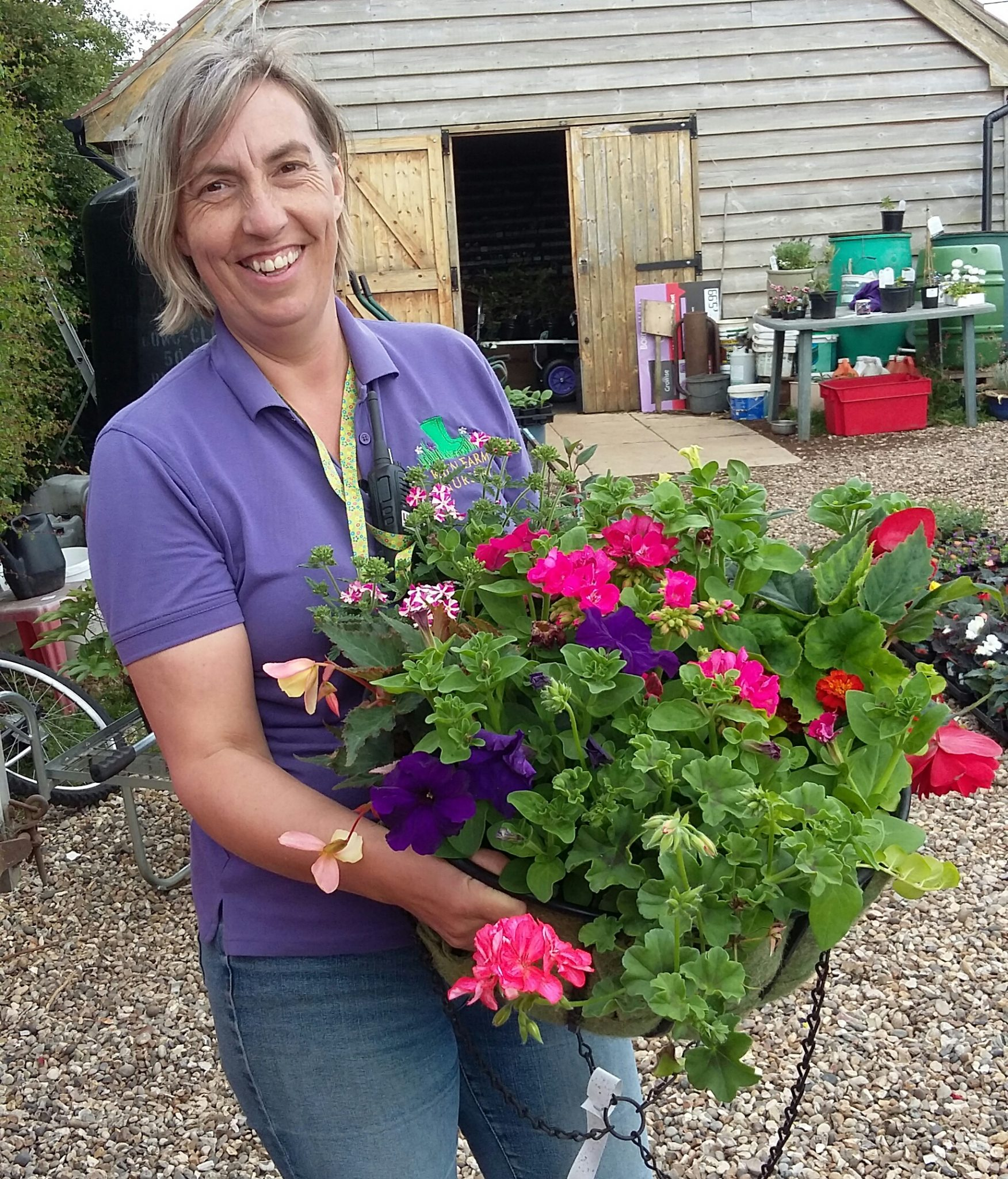 Ruth Goudy planting hanging baskets